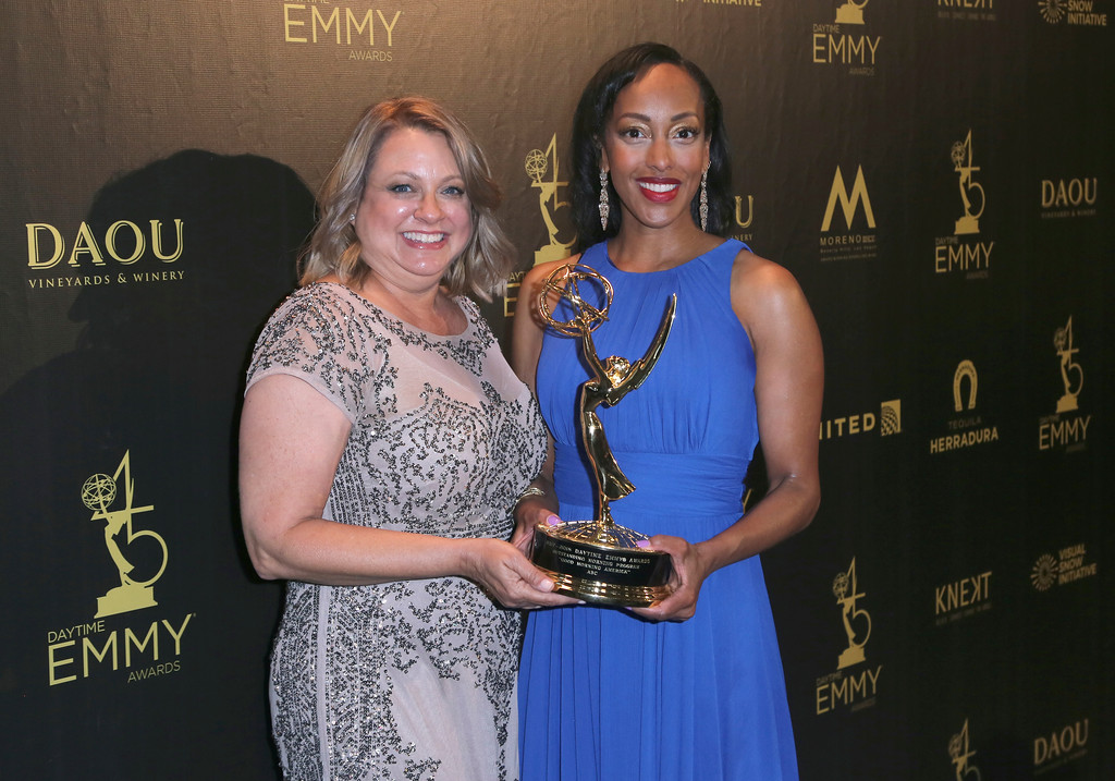 ". Lisa Sivertsen, left, and Sabina Ghebremedhin pose in the press room with the award for outstanding morning program for ""Good Morning America\"" at the 45th annual Daytime Emmy Awards at the Pasadena Civic Center on Sunday, April 29, 2018, in Pasadena, Calif. (Photo by Willy Sanjuan/Invision/AP)"