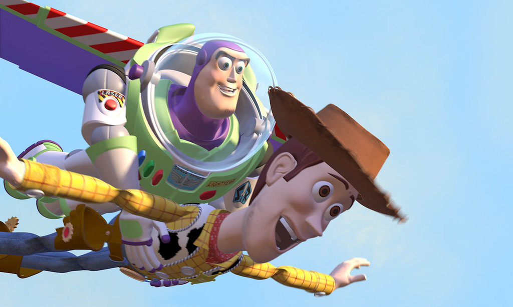 ". Buzz Lightyear gives a ride to Woody the cowboy in Pixar\'s ""Toy Story.\"" Walt Disney Studios"