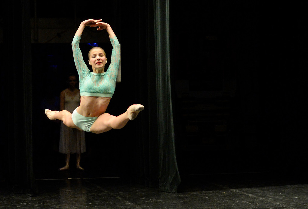 . Salt Lake City dancer 14-year-old Sophia Vance leaps through the air as hundreds of ballet dancers came to The Theater at Colorado Heights University in Denver  to compete in the  Youth America Grand Prix Regional semi-finals on Friday, February 19, 2016.  The weekend competition was for dancers to earn scholarships and invitations to  dance companies.    (Photo by Cyrus McCrimmon/ The Denver Post)