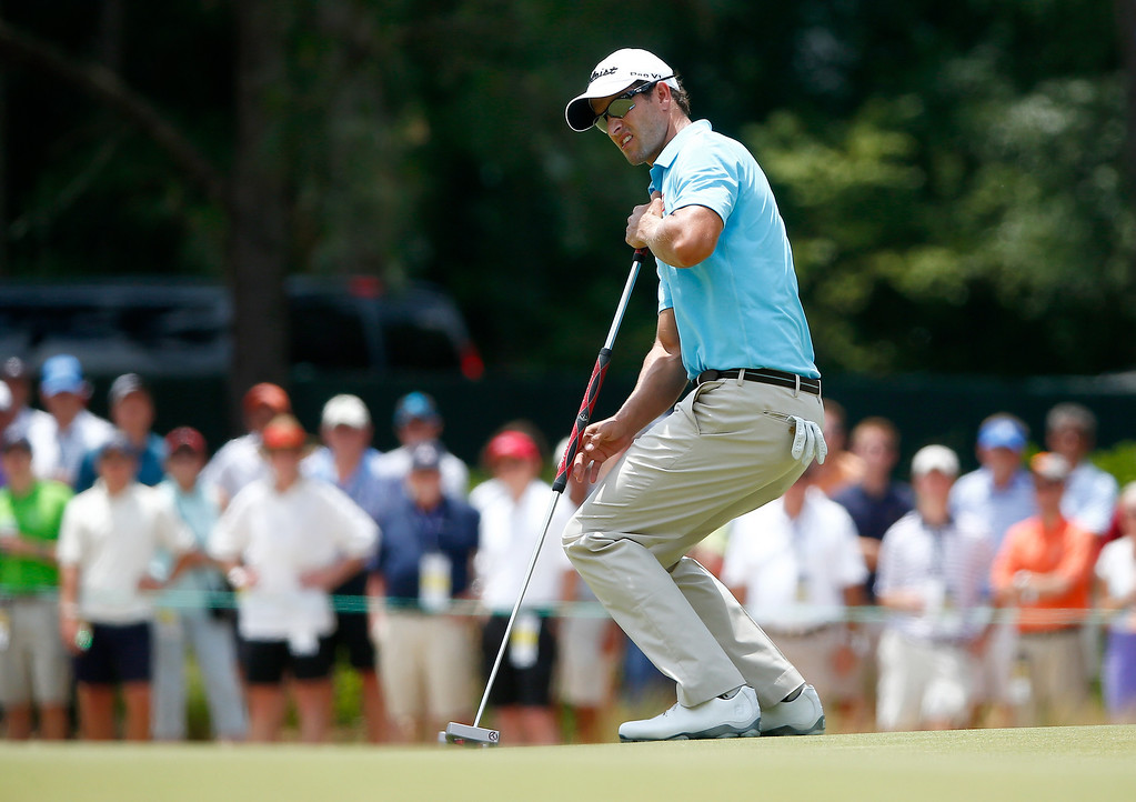 . Adam Scott of Australia watches a putt on the first green during the first round of the 114th U.S. Open at Pinehurst Resort & Country Club, Course No. 2 on June 12, 2014 in Pinehurst, North Carolina.  (Photo by Sam Greenwood/Getty Images)
