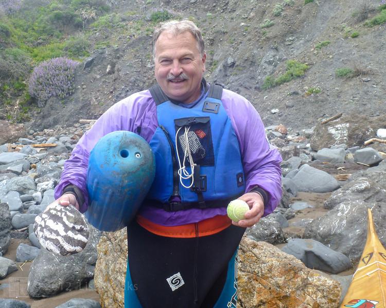 Ken's treasure, a rock, a bouy, and a ball.