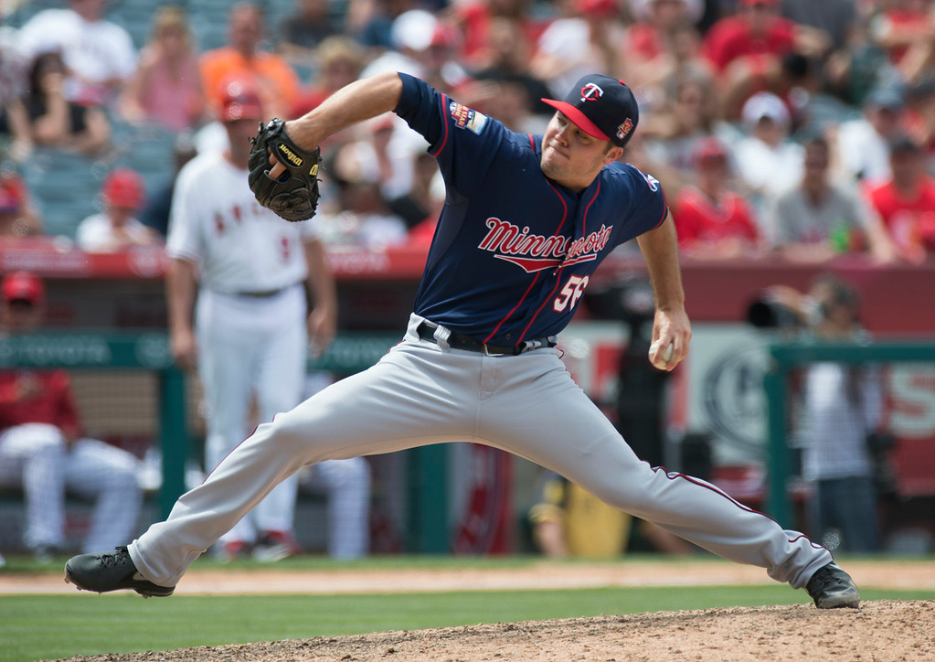 . The Minnesota Twins\' Caleb Thiebar (#56) makes a pitch as they play the Angels at Angel Stadium in Anaheim on Thursday June 26, 2014. The Angels beat the Minnesota Twins 6-4. (Photo by Keith Durflinger/Whittier Daily News)