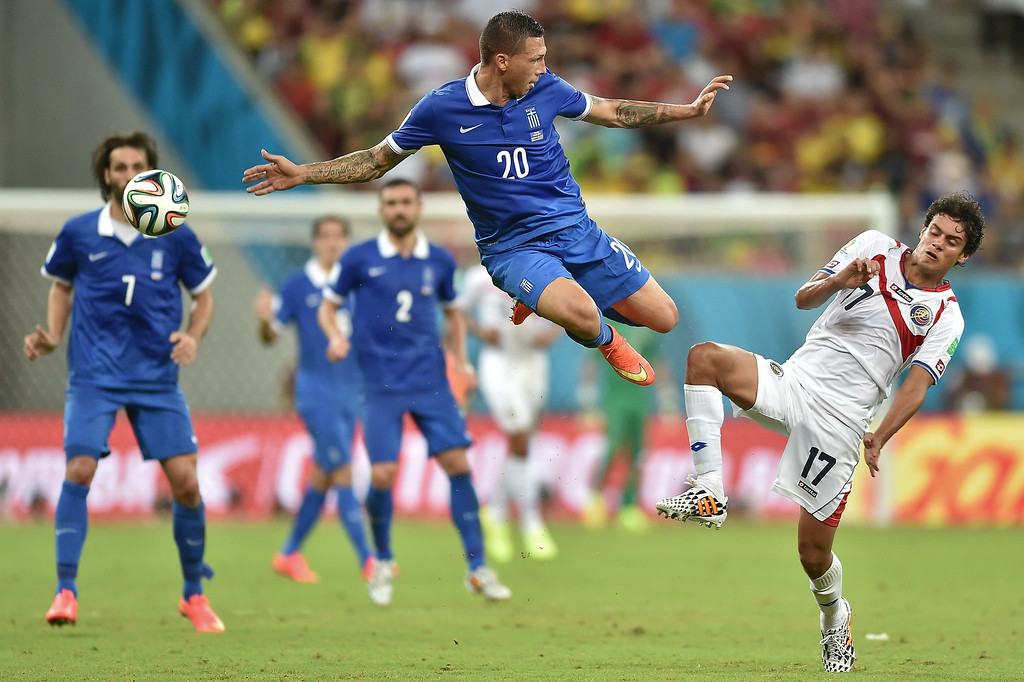 . Greece\'s defender Jose Holebas  (L) vies with Costa Rica\'s midfielder Yeltsin Tejeda, during a Round of 16 football match between Costa Rica and Greece at Pernambuco Arena in Recife during the 2014 FIFA World Cup on June 29, 2014.   ARIS MESSINIS/AFP/Getty Images