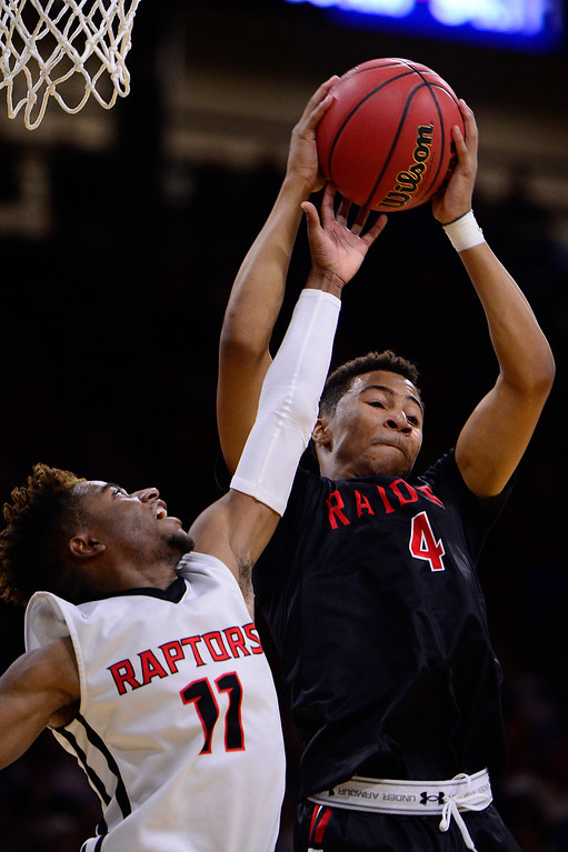 . Elijah Wilson (11) of Eaglecrest battles with Jalen Guidry (C) (4) of Rangeview over a rebound during the second quarter at the Coors Events Center on March 11, 2016 in Boulder, Colorado.(Photo by Brent Lewis/The Denver Post)