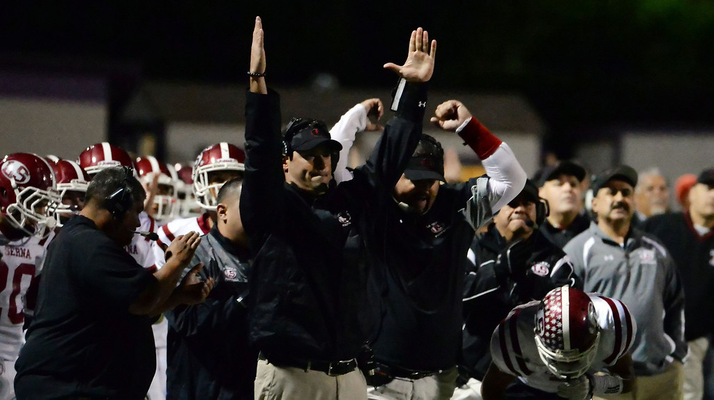 . La Serna bench reacts after a Bryce Oliver (not pictured) touchdown in the first half of a CIF-SS playoff football game against Diamond Bar at Diamond Bar High School in Diamond Bar, Calif., on Friday, Nov. 22, 2013.   (Keith Birmingham Pasadena Star-News)