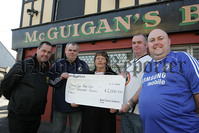 Sr Julie Grant from the Special Care Baby Unit at Daisy Hill Hospital recieves a cheque for £2000 from, Gerry McGuigan, Jim Mcmahon, Joe McLoughlin and Eamonn Magee. The money was raised through a charity football match between the Chelsea and Leeds supporters clubs last August. 07W6N32