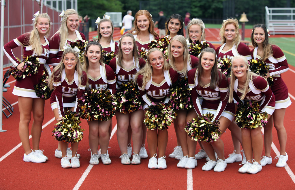 . Randy Meyers - The Morning Journal<br> The Avon Lake varsity cheerleaders pose for a photo prior to Friday\'s game against Avon.