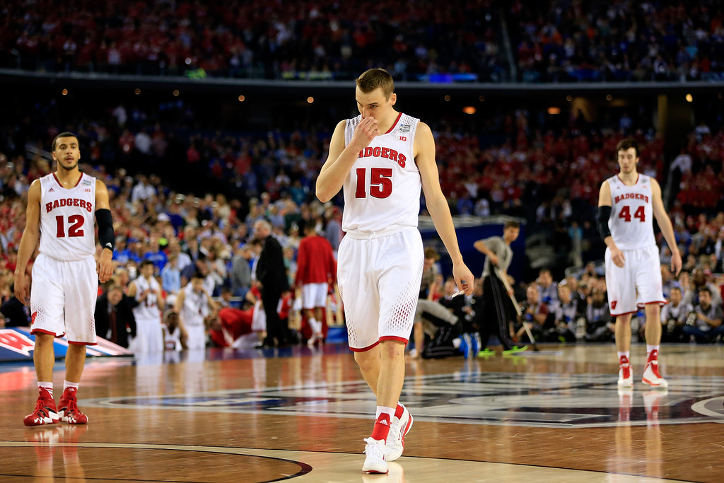 . ARLINGTON, TX - APRIL 05: Sam Dekker #15 of the Wisconsin Badgers walks off the court after losing to the Kentucky Wildcats 74-73 in the NCAA Men\'s Final Four Semifinal at AT&T Stadium on April 5, 2014 in Arlington, Texas.  (Photo by Jamie Squire/Getty Images)