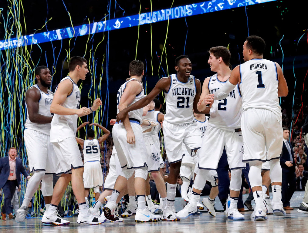 . Villanova players celebrate after the championship game against Michigan in the Final Four NCAA college basketball tournament, Monday, April 2, 2018, in San Antonio. Villanova won 79-62. (AP Photo/David J. Phillip)