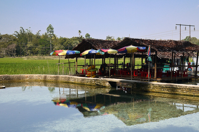 Small restaurants dot the swimming hole near the Kawkathaung and Ruby Cave s in the countryside near Hpa-An, Burma.