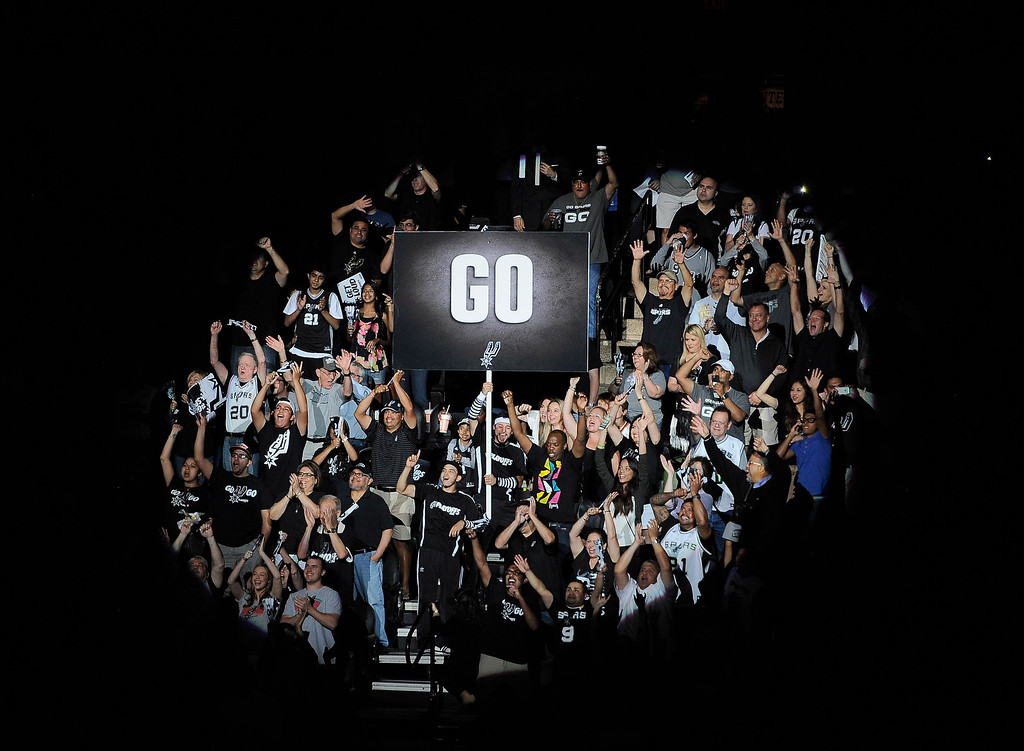 . San Antonio Spurs fans cheer before Game 2 of the Western Conference finals NBA basketball playoff series against the Oklahoma City Thunder, Wednesday, May 21, 2014, in San Antonio. (AP Photo/Darren Abate)