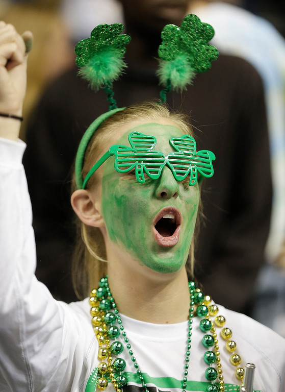 . A Notre Dame fan cheers before the first half of the championship game between Notre Dame and Connecticut in the Final Four of the NCAA women\'s college basketball tournament, Tuesday, April 8, 2014, in Nashville, Tenn. (AP Photo/Mark Humphrey)