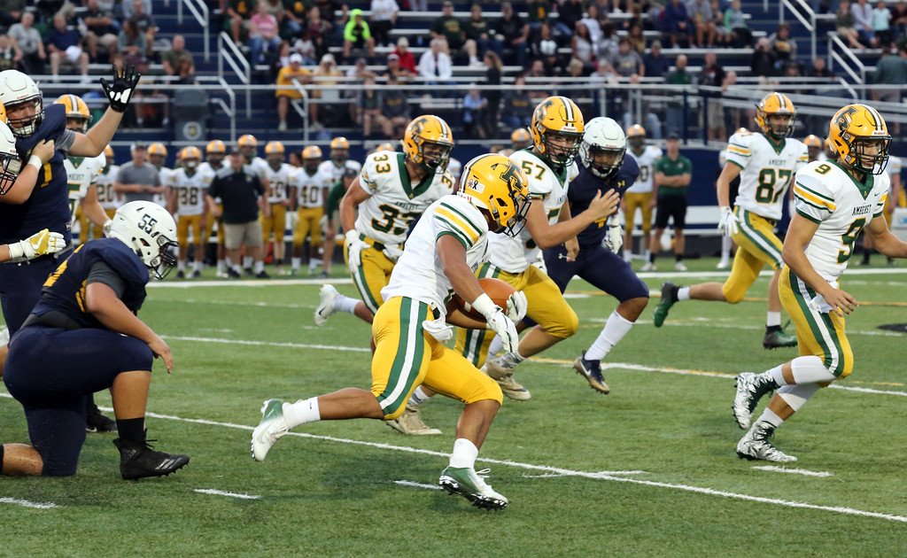 . David Schneider - The Morning Journal<br> Amherst\'s Khennedy Scagliozzo makes a lengthy run in the first quarter against North Ridgeville on Sept. 7.
