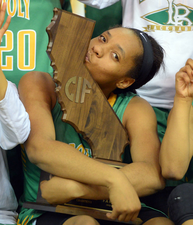 . Long Beach Poly senior Jada Matthews kisses their state championship trophy after beating Salesian at Sleep Train Arena in Sacramento, CA on Saturday, March 29, 2014. Long Beach Poly vs Salesian in the CIF Open Div girls basketball state final. 2nd half. Poly won 70-52. (Photo by Scott Varley, Daily Breeze)