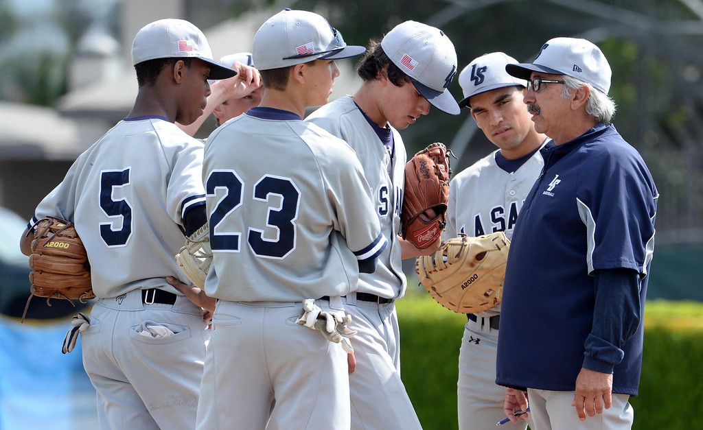 . La Salle head coach Harry Agajanian, right, talks with starting pitcher Brandon Jenkins in the second inning of prep baseball game against Bishop Amat  at Bishop Amat High School in La Puente, Calif., on Tuesday, May 6, 2014. (Keith Birmingham Pasadena Star-News)