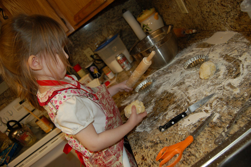 Helping mama make pies for thanksgiving.