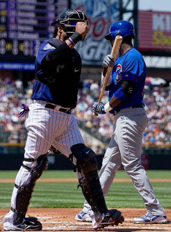 . Catcher Yorvit Torrealba #8 of the Colorado Rockies pumps his fist after Junior Lake #21 of the Chicago Cubs strikes out during the first inning at Coors Field on July 21, 2013 in Denver, Colorado.  (Photo by Justin Edmonds/Getty Images)