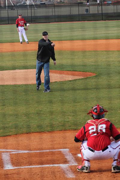 Former GWU baseball player, Blake Lalli throws the first pitch in John Henry Moss Stadium.