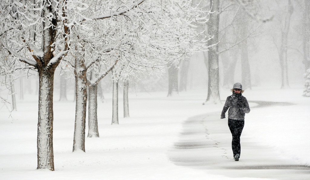. May 1st a great day for a run, in a blizzard. This runner pushes through a morning workout at a scenic but cold and wet City Park. (Photo By Cyrus McCrimmon/The Denver Post)