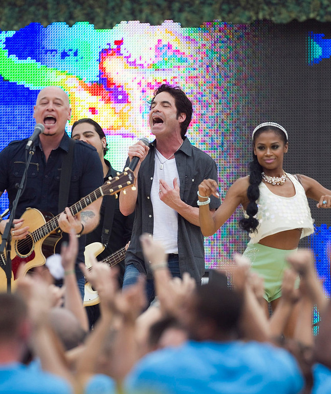 . The musical group Train performs before the start of the NFL Pro Bowl football game in Honolulu, Sunday, Jan. 27, 2013. (AP Photo/Marco Garcia)