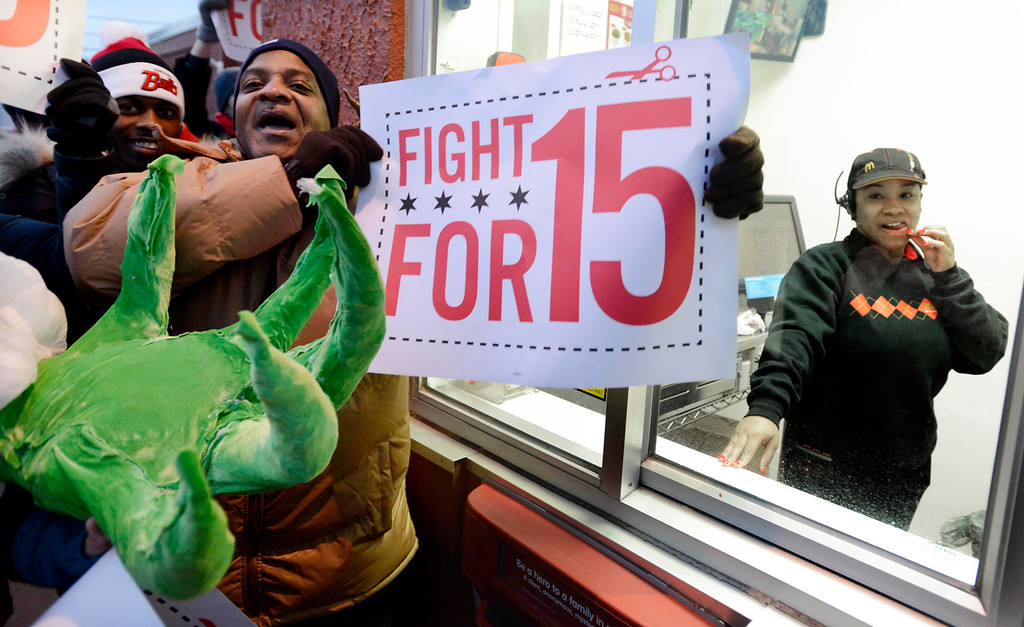 . Protesters protest for higher wages outside a McDonalds restaurant in Chicago, Thursday, Dec., 5, 2013.  (AP Photo/Paul Beaty)