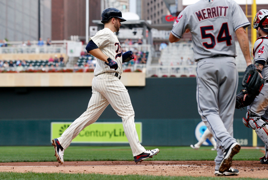 . Minnesota Twins\' Brian Dozier scores on a single by Eduardo Escobar off Cleveland lndians pitcher Ryan Merritt during the third inning of the second game of a baseball doubleheader Thursday, Aug. 17, 2017, in Minneapolis. (AP Photo/Jim Mone)