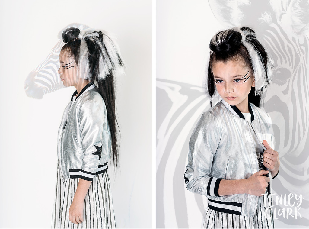Playful studio kids fashion editorial with kids mimicking animals and double exposures featured on Babiekins Magazine blog by Tenley Clark Photography. Styling: Jeneffer Jones. HMUA: Amy Lawson. Model: Mila. Zebra look.
