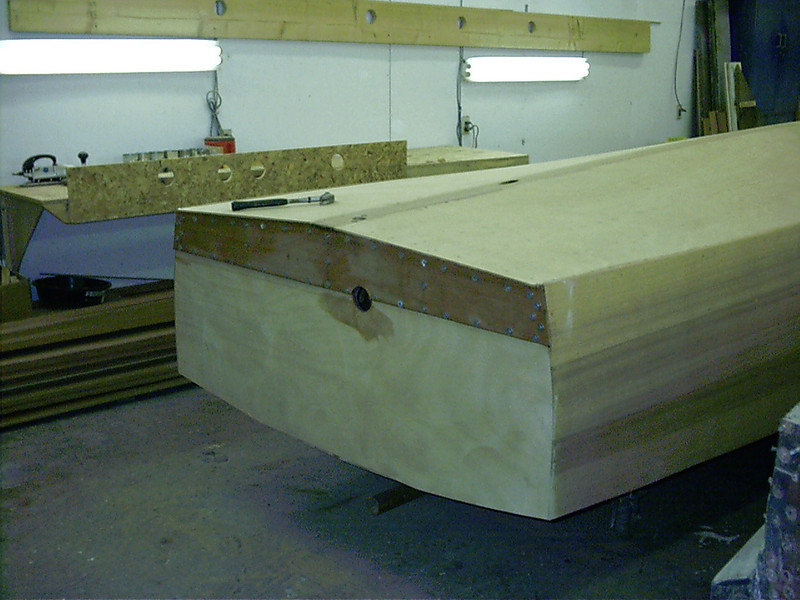 Bottom transom plank epoxied and held in place with tempory fasteners.