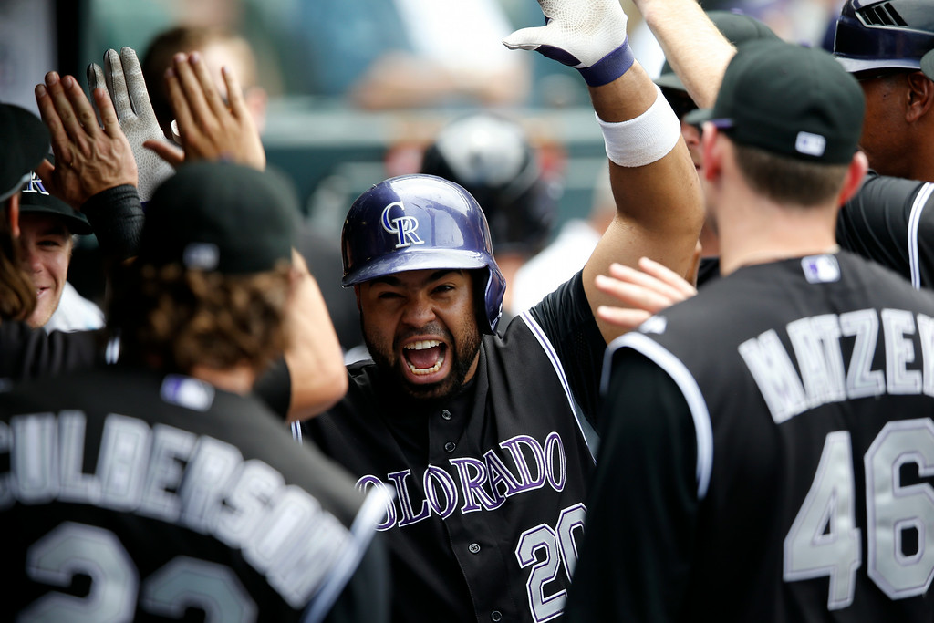 . Colorado Rockies\' Wilin Rosario celebrates a solo home run off San Diego Padres starting pitcher Eric Stults during the fourth inning of a baseball game on Wednesday, July 9, 2014, in Denver. (AP Photo/Jack Dempsey)