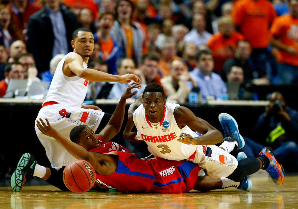 . BUFFALO, NY - MARCH 22: Jerami Grant #3 of the Syracuse Orange and Jordan Sibert #24 of the Dayton Flyers battle for a loose ball during the third round of the 2014 NCAA Men\'s Basketball Tournament at the First Niagara Center on March 22, 2014 in Buffalo, New York.  (Photo by Jared Wickerham/Getty Images)