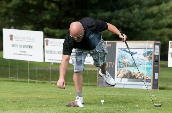 09/24/19 Wesley Bunnell | StaffrrBristol Police Ofc. Lang Mussen puts down his cigar before teeing off during the Ed Beardsley Little League Challenger Golf Tournament at Chippanee Golf Club on Tuesday afternoon.