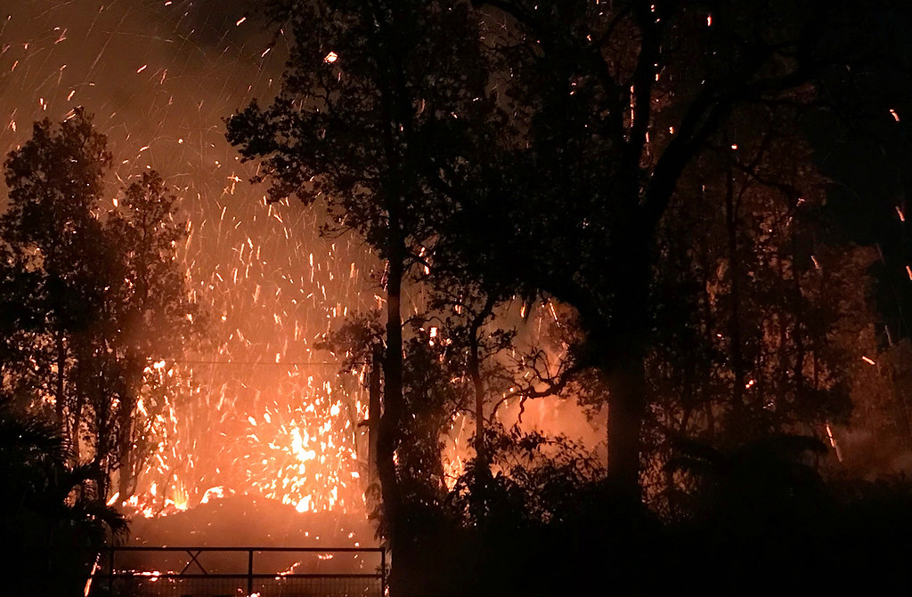 . This photo provided by Shane Turpin shows results of the eruption from Kilauea Volcano on Hawaii\'s Big Island Friday, May 4, 2018. The eruption sent molten lava through forests and bubbling up from paved streets and forced the evacuation of about 1,500 people who were still out of their homes Friday after Thursday\'s eruption. (Shane Turpin/seeLava.com via AP)
