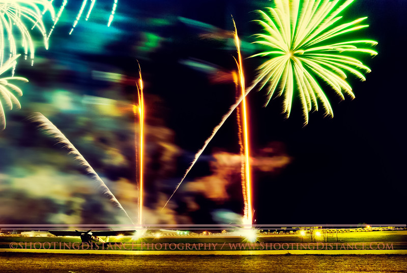 Fireworks behind a parked plane, Oshkosh Air Show 2012
