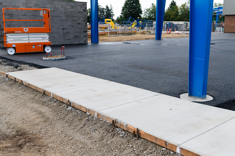 New cement and asphalt laid under the outdoor play structure at Gubser Elementary on Friday, August 16, 2019, in Keizer, Ore.