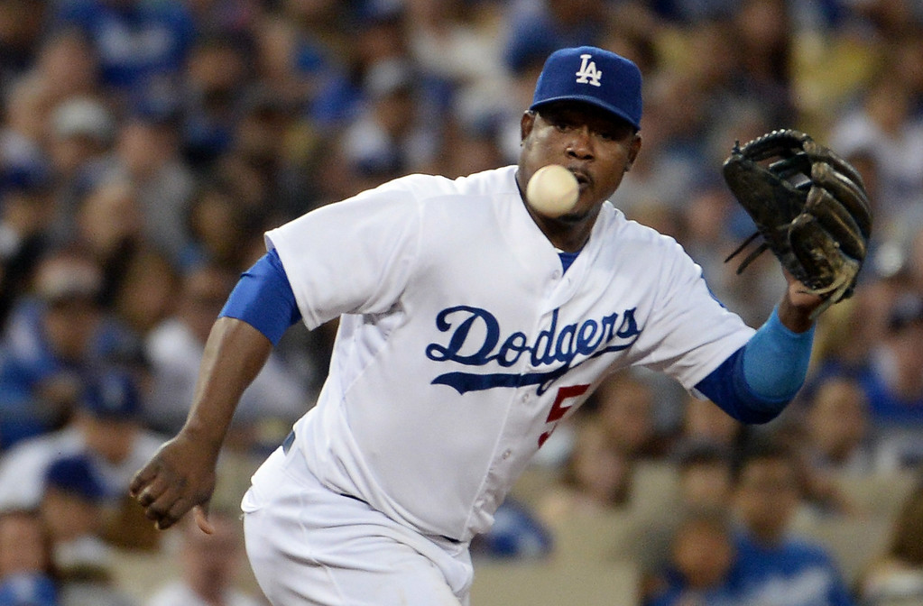 . Los Angeles Dodgers third baseman Juan Uribe makes the play on a ground ball by San Diego Padres\' Rene Rivera (not pictured) in the  fifth inning of a Major league baseball game on Saturday, July 12, 2014 in Los Angeles.   (Keith Birmingham/Pasadena Star-News)