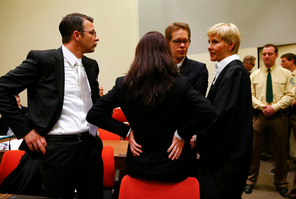 . Beate Zschaepe, a member of the neo-Nazi group National Socialist Underground (NSU), speaks to her lawyers Anja Sturm (R), Wolfgang Heer and Wolfgang Stahl (L) in the court before the start of the trial in Munich on May 6, 2013.   REUTERS/Michael Dalder