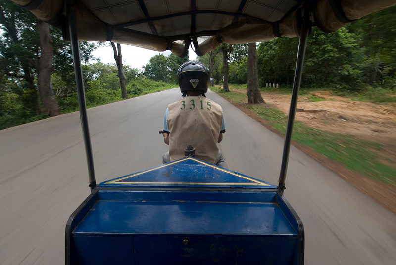 Riding the tuk tuk, a common form of transportation in Cambodia