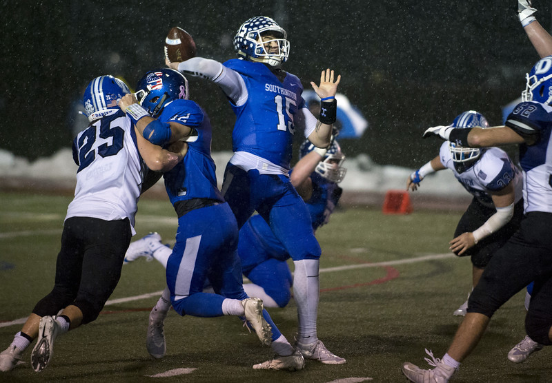 12/09/19  Wesley Bunnell | Staff  Southington football was defeated at home in a CIAC playoff game against Darien on a rainy Monday night December 9, 2019.  Brady Lafferty (15) stands in the pocket to pass.