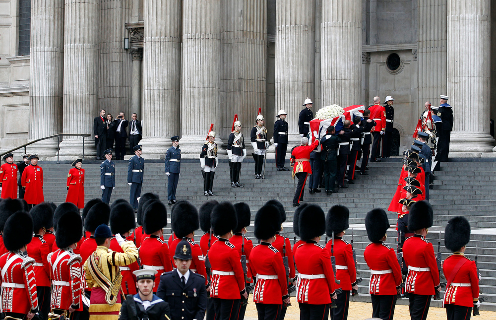 . The coffin of former British Prime Minister Margaret Thatcher is carried aloft by members of the armed forces into St Paul\'s Cathedral, central London for her funeral Wednesday April 17, 2013. (AP Photo/Dave Thompson/PA)