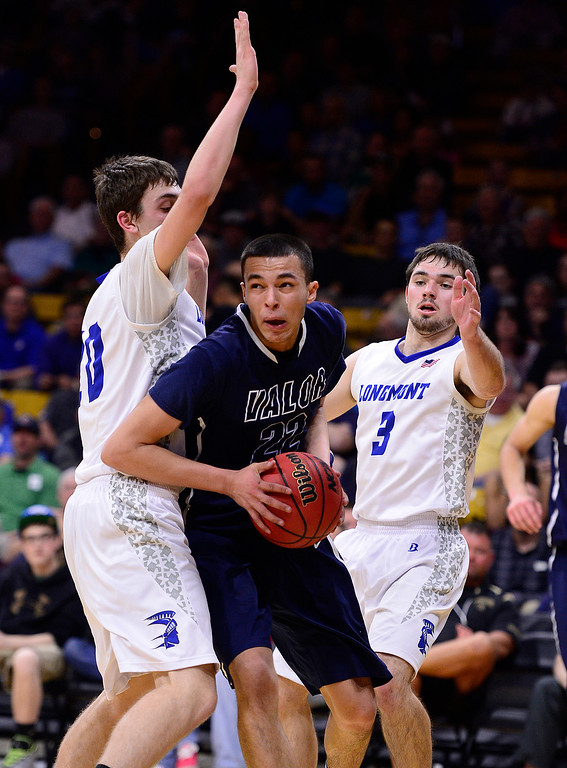 . Jalen Sanders (22) of Valor Christian tries to move around Ryan Rulon (20) of Longmont to get to the hoop during the second quarter at the Coors Events Center on March 11, 2016 in Boulder, Colorado. Pueblo West defeated Vista Ridge 65-54 to advance to the 4A finals of Colorado state basketball tournament.  (Photo by Brent Lewis/The Denver Post)