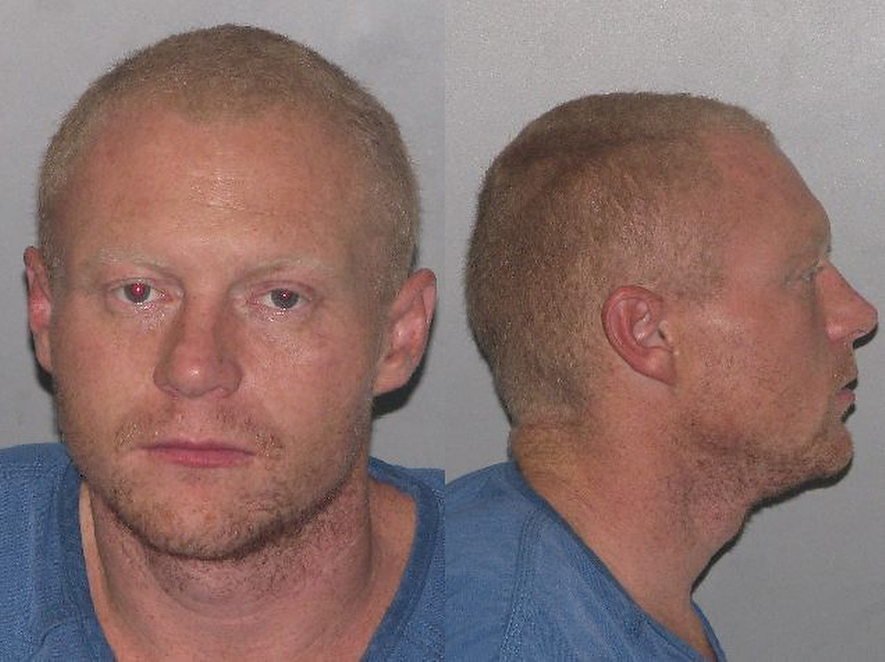 Description of . Jason Allen Lewis   Garfield County, Colorado: On Friday, December 9th, 2011, at approximately 7:00 p.m., Garfield County Emergency Communications advised Garfield County Sheriff's Office deputies of a dark colored sport utility type vehicle driving erratically on I-70. After running the plate on the vehicle, it was discovered that the vehicle was reported stolen out of Grand Junction. Within 15 minutes, deputies were able to locate the stolen vehicle on County Road 315, where a short vehicle pursuit developed. The pursuit was called off at approximately mile marker 3.2 on County Road 315. Within minutes, deputies located the stolen Honda Ridgeline crashed into a stack of metal pipes, which were a part of a pipeline under construction. Before deputies arrive on scene, the driver left the scene on foot. The first deputy to arrive on the scene of the accident was a certified tracking canine team and a track for the suspect began immediately. Canine Bak and his handler tracked the area for approximately one hour in freezing conditions. The canine team was called off and Garfield County Sheriff's Detectives were called to photograph and process the scene.      A little over three hours later, at 10:52 p.m., Garfield County Emergency Communications contacted Sheriff's Deputies about a burglary in progress at a residence in the area of mile marker 1 on County Road 352, southeast of the Garfield County Regional Airport and approximately a mile and a half north of the crash site. The home owner noticed suspicious activity when they left the door unlocked and came home to a locked house. When deputies arrived at the residence, they noticed several shoeprints track out the back door. Jewelry and clothing were stolen from the house. Deputies also noticed that the shoe prints recovered from the pursuit scene were identical to the shoe prints at the home burglary. Another certified tracking canine team, Ejon and his handler were deployed and tracked the suspect 