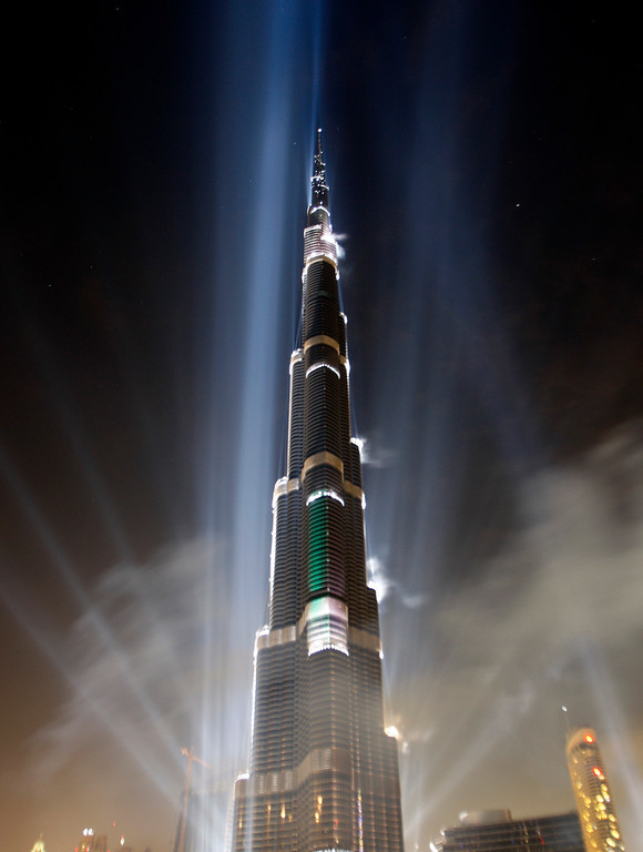 . In this Jan. 4, 2010 file photo, the Burj Khalifa is illuminated during the official opening ceremony in Dubai, United Arab Emirates. According to the nonprofit Council on Tall Buildings and Urban Habitat, the Burj Khalifa is the tallest completed building in the world with the height measured at 2,717 feet. (AP Photo/Kamran Jebreil, File)