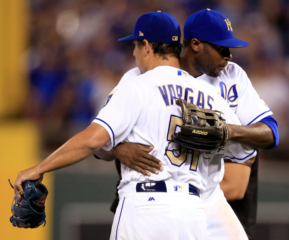 . Kansas City Royals starting pitcher Jason Vargas (51) gets a hug from center fielder Lorenzo Cain following the team\'s baseball game against the Cleveland Indians at Kauffman Stadium in Kansas City, Mo., Friday, June 2, 2017. The Royals won 4-0. (AP Photo/Orlin Wagner)