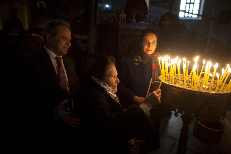 . Visitors light candles in the Church of the Nativity on December 24, 2014 in Bethlehem, West Bank. Every Christmas pilgrims travel to the church where a gold star embedded in the floor marks the spot where Jesus was believed to have been born.  (Photo by Lior Mizrahi/Getty Images)