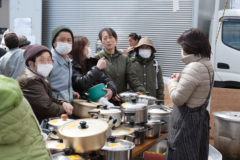 Patently waiting for the Tonjiru to be well cooked and ready for distribution.