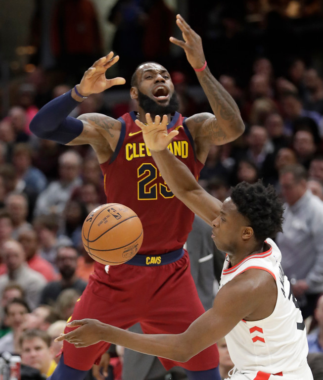 . Toronto Raptors\' OG Anunoby, right, knocks the ball loose from Cleveland Cavaliers\' LeBron James during the second half of an NBA basketball game Wednesday, March 21, 2018, in Cleveland. The Cavaliers won 132-129. (AP Photo/Tony Dejak)