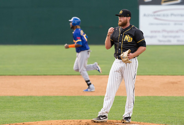 08/13/19 Wesley Bunnell | Staff the New Britain Bees vs the High Point Rockers at New Britain Stadium on Tuesday August 13, 2019. Pitcher David Roseboom (25) stands on the mound as a High Point baserunner rounds second base after hitting a home run.