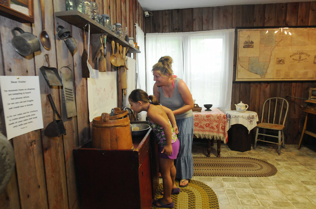 . Sarah Sabelko, right, of Ella, Wisconsin visits the Pepin Historical Museum aka The Laura Ingalls Wilder Museum on hwy 35 in  Pepin, Wisconsin with her daughter, Sawyer, 6. The museum includes items connected to children\'s author, Laura Ingalls Wilder, as well as other artifacts from Pepin\'s past history relating to Wilder and the time frame in which she lived. (Pioneer Press: Ginger Pinson)