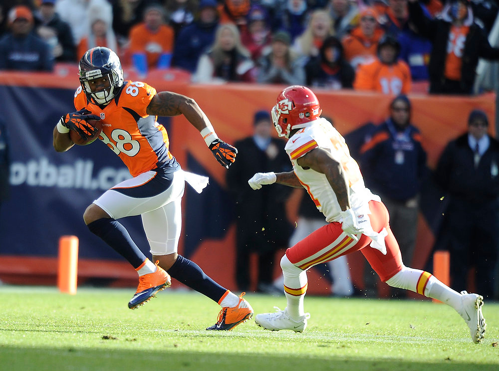 . Denver Broncos wide receiver Demaryius Thomas (88) is chased by Kansas City Chiefs cornerback Javier Arenas (21) as the Denver Broncos took on the Kansas City Chiefs at Sports Authority Field at Mile High in Denver, Colorado on December 30, 2012. Tim Rasmussen, The Denver Post