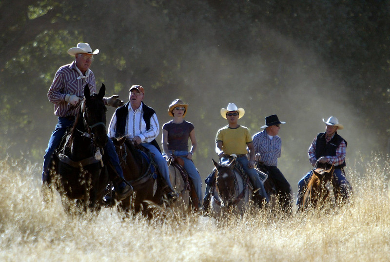 Bill Colvin, Don Batie, Renee Renner, Ben Juiliano, Del Kalbach, and Bob Baylor (left to right) ride thier horses Park along the trails in Upper Bidwell Park near the Easter Cross Saturday for the Chico Equestrian Association Poker Ride to raise money for arena upkeep. - halley photo 10/21/06